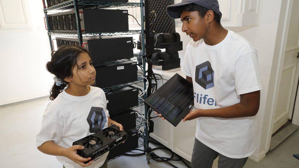 Siblings Ishaan and Aanya Thakur holding mining equipment